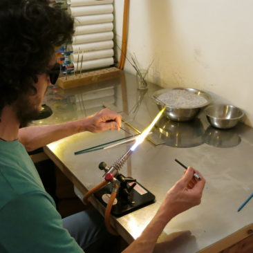 Students enjoying the art of glass bead making