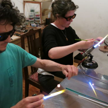 Students enjoying the art of glass bead making